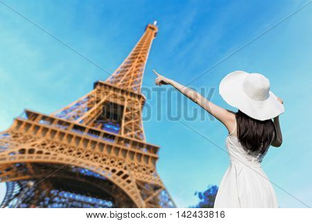 young woman wear dress and behind you with eiffel tower