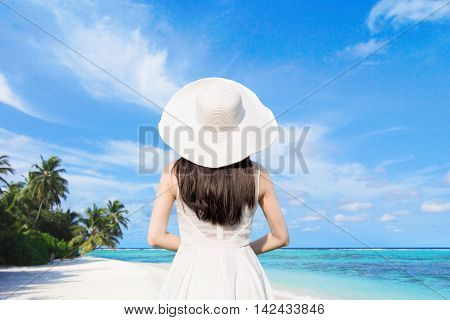young woman wear dress and relax look beach and sea