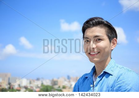 man smile happily to you with blue sky asian