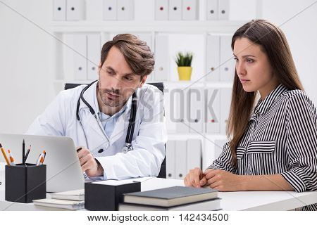 Woman And Doctor Look At Screen