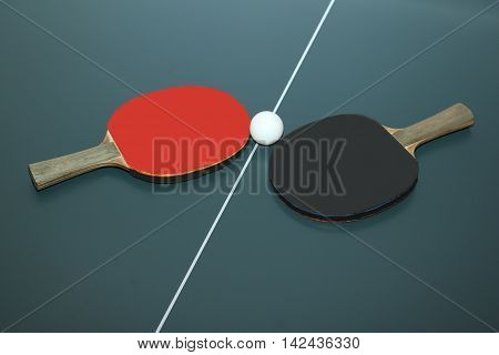 Two tennis rackets and ball on a table line