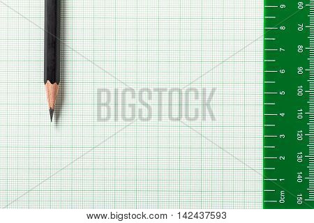 Pencil and Ruler on green graph paper with copy space poster