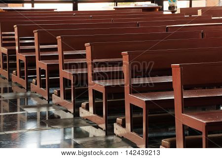 Wooden church pews in church and no people