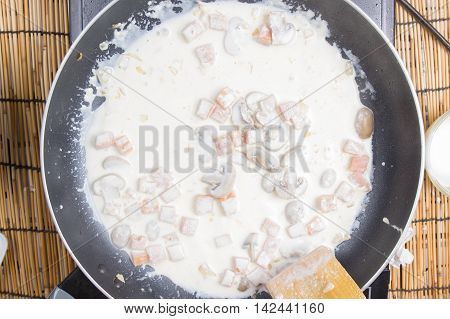 Chef cooking Spaghetti carbonara / cooking spaghetti concept
