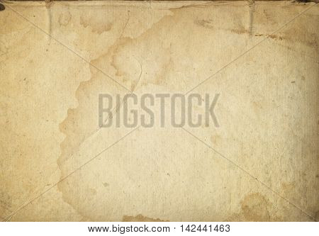 Aged stained and dirty paper background. Natural old paper texture for the design.