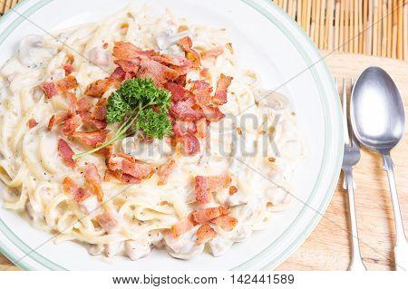 spaghetti carbonara on the plate / cooking spaghetti concept