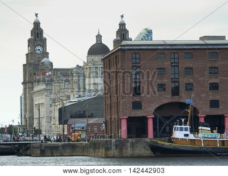 LIVERPOOL, ENGLAND, JULY 2. Pier Head on July 2, 2016, in Liverpool, England. Liverpool landmarks include the Albert Dock The Royal Liver Building Cunard Building Port of Liverpool Building and the Mann Island Building.