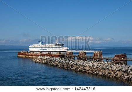 Tsawwassen, British Columbia, Canada - August 04 2016: BC Ferry arrives to ferry terminal at Tsawwassen August 04 2016. The terminal primarily serves routes travelling to the Swartz Bay Ferry Terminal north of Victoria and the southern gulf islands.