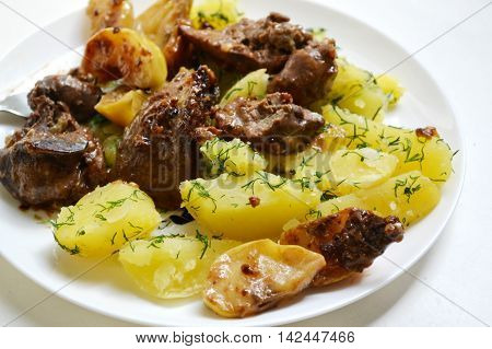 Baked potato with roasted duck liver and apples