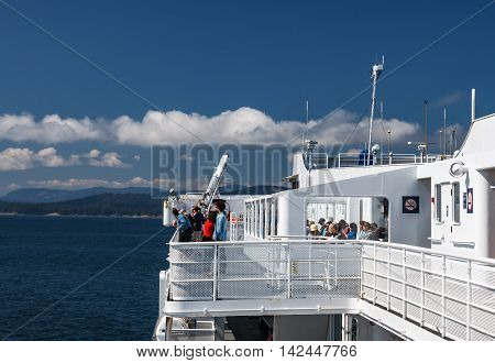 TSAWWASSEN DELTA BRITISH COLUMBIA - AUGUST 04 2016: Passengers on the sun deck of the BC Ferry. BC Ferries provides an essential link from mainland British Columbia to the various islands.