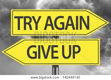 Try Again x Give Up yellow sign