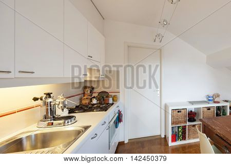 Kitchen of a loft, hob with steel sink