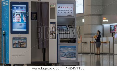 SEOUL, SOUTH KOREA - OCTOBER 22, 2015: International Calling Card machine next to photo booth in the airport of Incheon