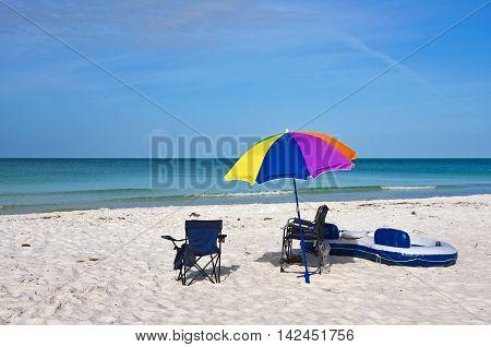 Beach Chairs with Umbrella and Raft on the Beach of Anna Maria Island Florida