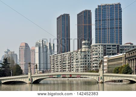 SHANGHAI CHINA - MARCH 26: Suzhou Creek on March 26 2016 in Shanghai China. Suzhou Creek (or Soochow Creek) also called Wusong River is a river that passes through the Shanghai city centre.