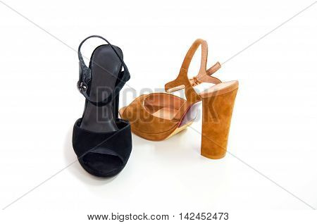 Two womens open-toe sandals isolated on white.;