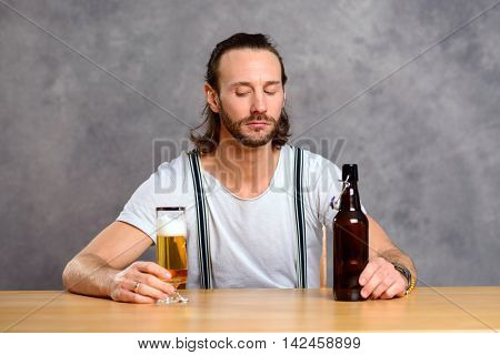 Young Man Drinking Beer