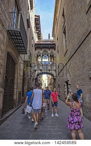 BARCELONA SPAIN - JULY 8 2016: Gothic bridge at Carrer del Bisbe Barcelona