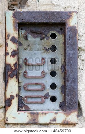 Detail of the old and damaged doorbells