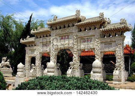 Kunming China - April 25 2006: Lion Gateway with multiple carved figures at the Hui Garden from Anhui Province at the World Horti-Expo Garden Exhibition Park
