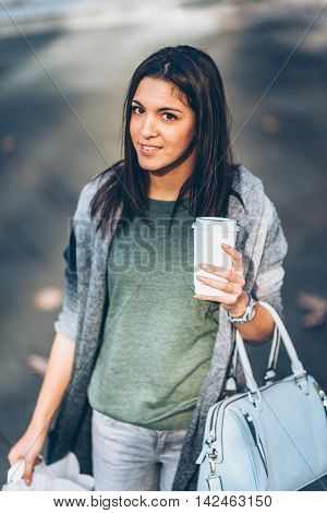 Girl With A Take-away Coffe Shopping