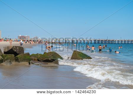 NEW YORK CITY, USA - JUNE 25, 2016: People enjoy summer on Coney Island beach