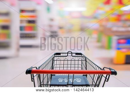 Shopping cart in supermarket. with baby safty sign on shoping car for Shopping Market  Background