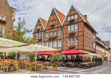 MUNSTER, GERMANY - AUGUST 7, 2016: Cafe in the historical center of Munster, Germany