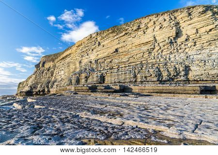 Carboniferous limestone cliffs of Southerndown Beach or Dunraven Bay afternoon light. Used as Bad Wolf Bay in Doctor Who. South Wales UK.