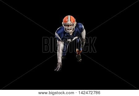 Professional american attacking football player in blue uniform isolated