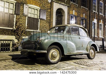 Morris Minor Convertible In A Street Of London Car At Night
