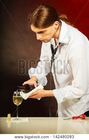 Wine Steward Fills Glass.