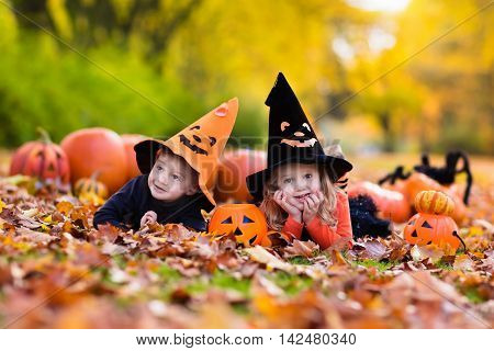 Kids With Pumpkins On Halloween