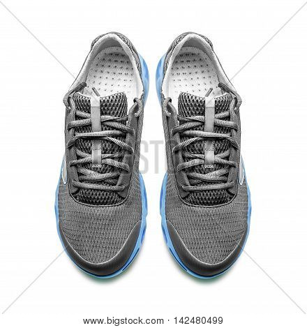Unbranded modern sneakers isolated on a white background. Top view.