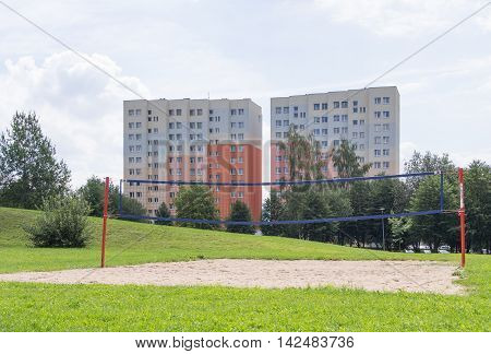 JELENIA GORA POLAND - AUGUST 13 2016: beach volleyball field in front of an industrialized apartment block