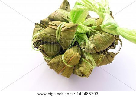 Steamed glutinous rice wrapped in bamboo leaf