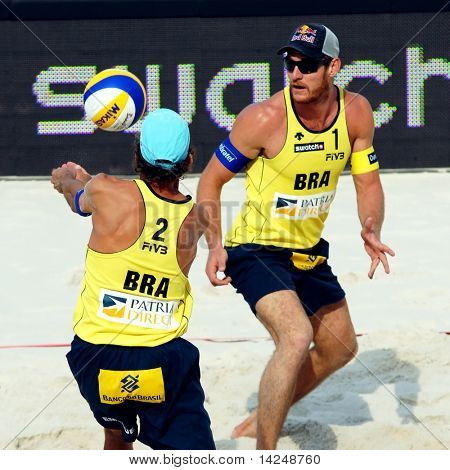PRAGUE - JUNE 18: Alison Cheruti (No. 1)  & Emanuel Rego (No. 2) compete in beach volleyball at the SWATCH FIVB World Tour 2010 on June 18, 2010 in Prague.