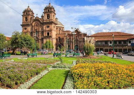 Iglesia de la Compania de Jesus on Plaza de Armas in Cusco Peru. In 1983 Cusco was declared a World Heritage Site by UNESCO poster