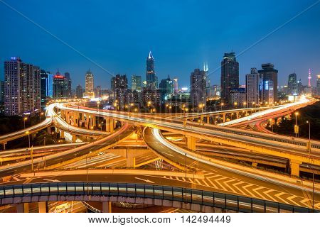 Shanghai elevated road junction and interchange overpass at night in Shanghai China