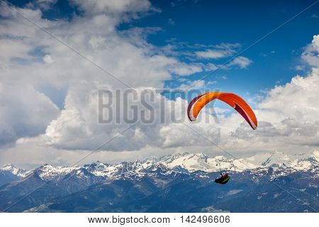 Paraglider above mountains near Brunico South Tyrol Italy