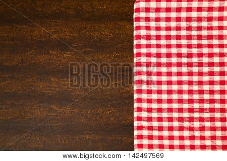 Background with wooden surface and checked tablecloth