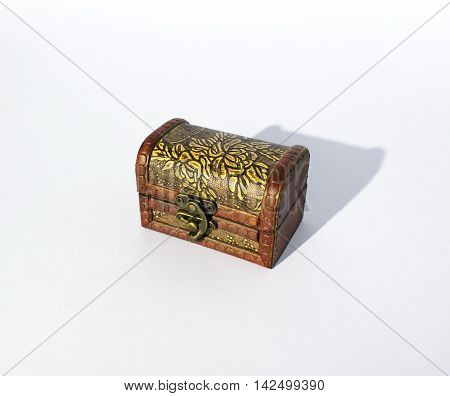 Ole wooden treasure chest in white background.