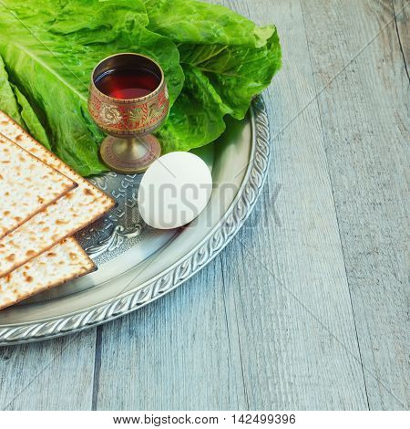 Jewish Passover seder celebration with matzos, egg and wine
