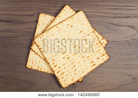 Matzo on wooden tabletop for Jewish Passover holiday