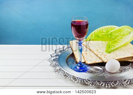 Background for Jewish Holiday Passover celebration with wine, egg and matzos