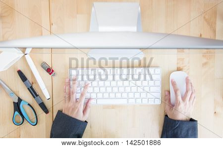 Top View Of Asian Woman Hand Working With Computer On Wooden Table