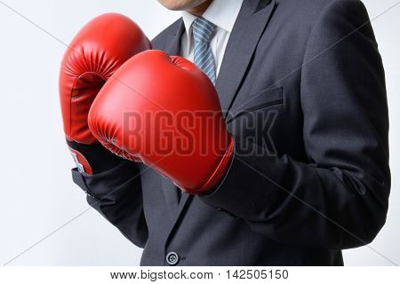 businessman with red boxing glove ready to fight with problem business concept