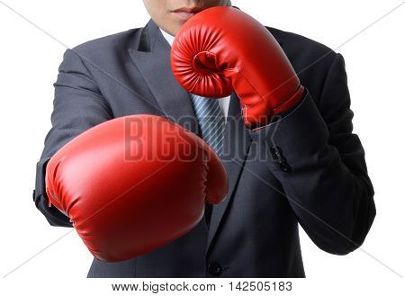 businessman with red boxing glove punch to the goal business concept