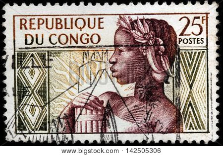 LUGA RUSSIA - JUNE 25 2016: A stamp printed by REPUBLIC OF THE CONGO shows image portrait of Congolese Girl. Allegory - Birth of the Republic circa 1959.