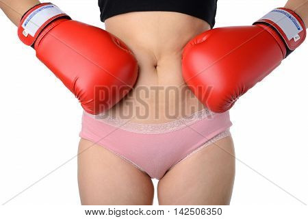 woman with the red boxing gloves fight with her belly Diet concept